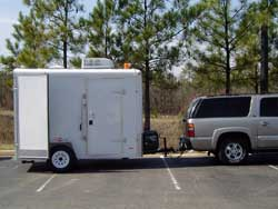 Econo Trailer sideview showing side door, and air conditioning